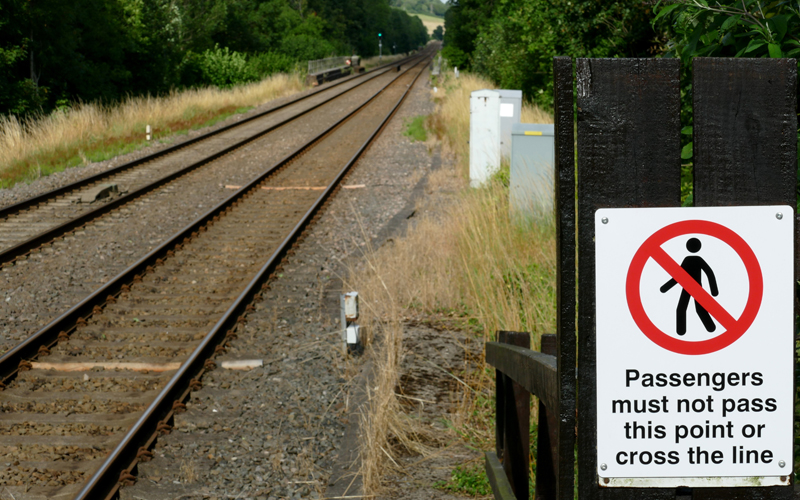 Rail trespass sign on side of tracks